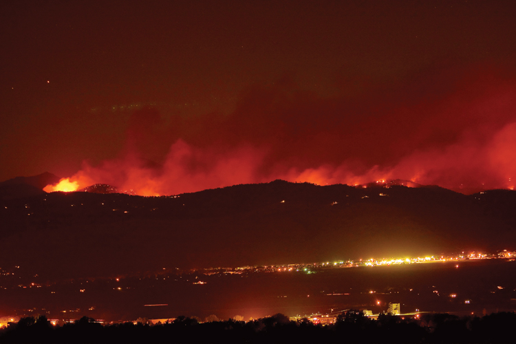 Fourmile Canyon Fire burning above Boulder | 2010 | Photo credit: James Insogna
