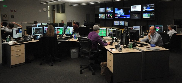 Meteorologists hard at work predicting the weather