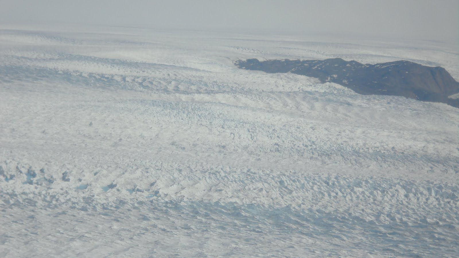 Another shot from plane. One lone mountain can be seen poking through the sea of ice.