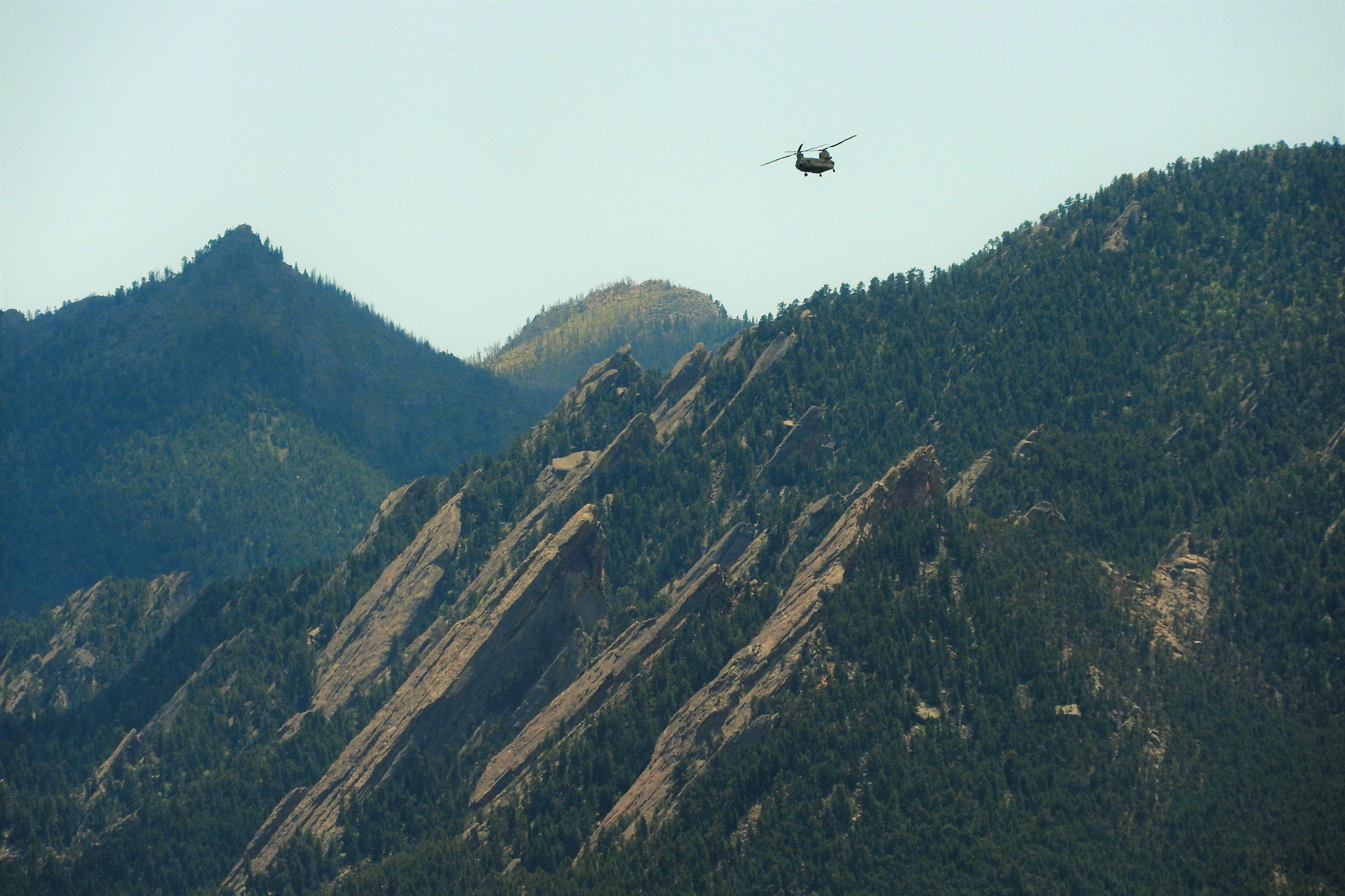 Chinook making a return flight past the Flatirons from the Cold Spring Fire.